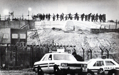 Greenham Common women dancing on silos January 1, 1983.